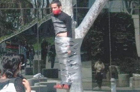 crazy-man-tied-to-tree_01.jpg